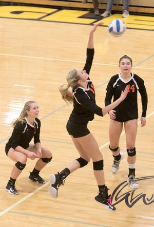 Madison Opre of Brighton returns a volley with Hannah Bedner, left, and Celia Cullen watching in a district semifinal match against Hartland on Tuesday, Oct. 30, 2018.