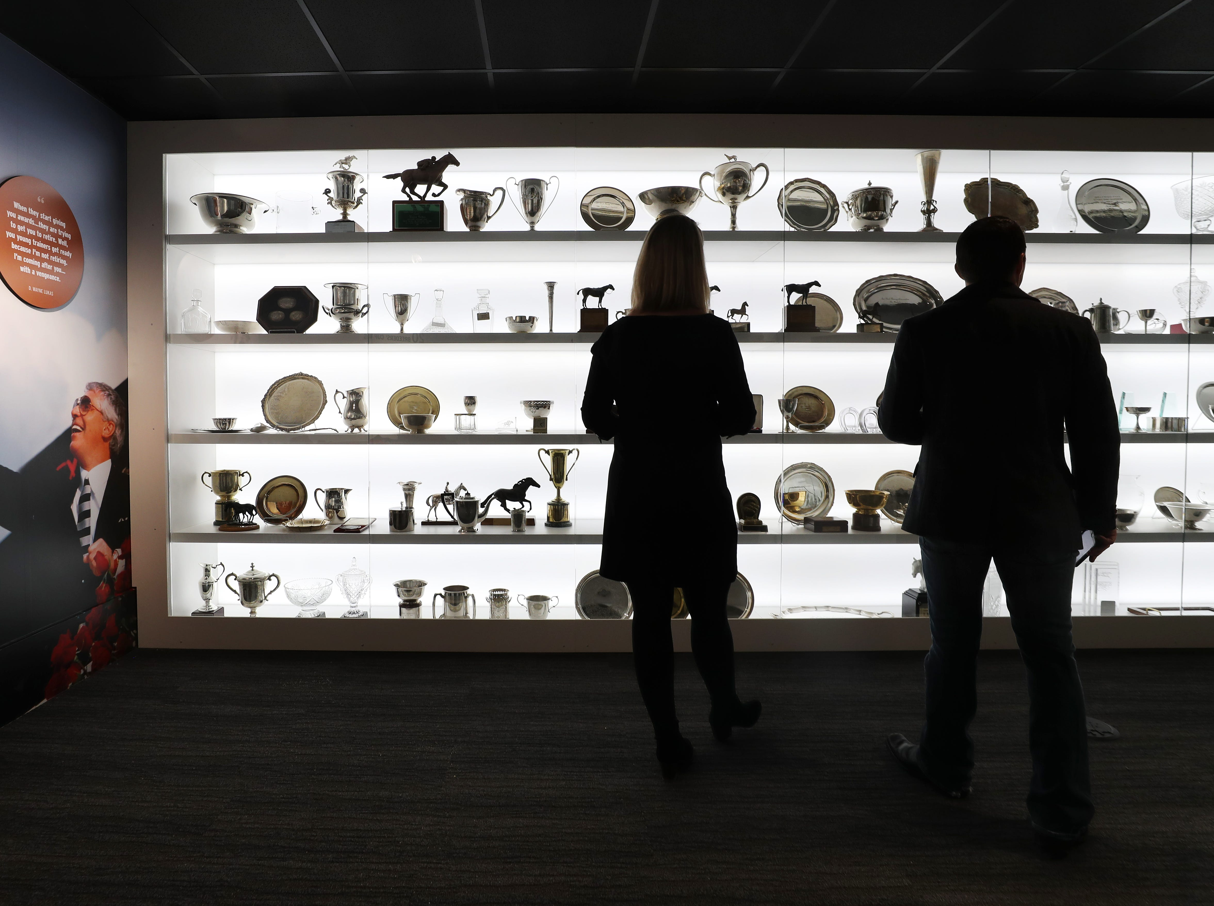 Lindsay English, left, communications manager for the Kentucky Derby Museum, gives Laffit Pincay, of NBC Sports, a tour of the museum expansion ahead of their grand exhibit reveal.  They were viewing the D. Wayne Lukas gallery.  Pinclay will be the master of ceremonies for the event.  Oct. 31, 2018