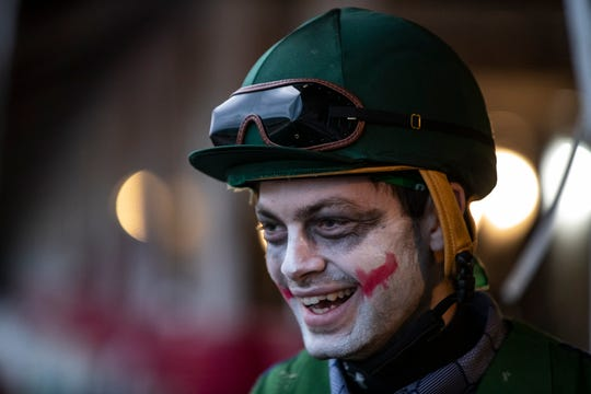Brody Wilkes wore Joker makeup while exercising horses at Churchill Downs on Halloween. Oct. 30, 2018.