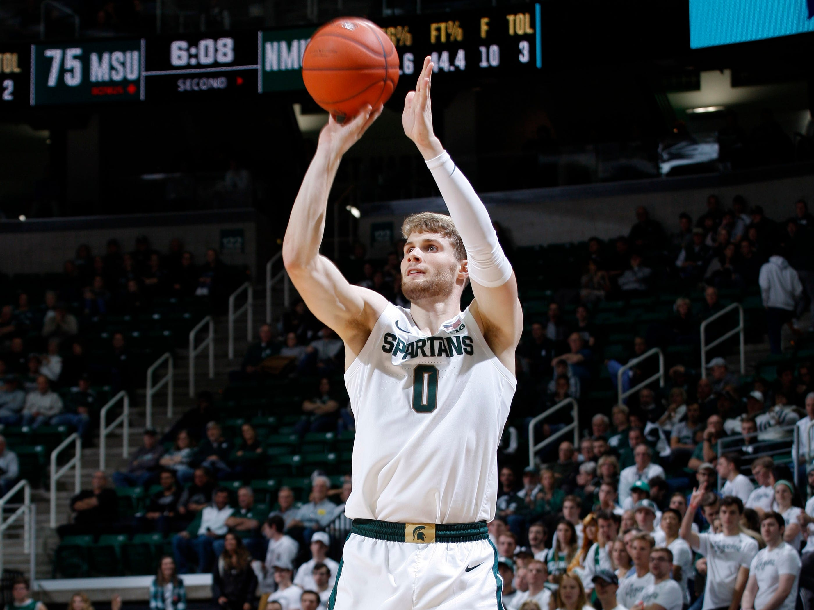 Michigan State's Kyle Ahrens shoots against Northern Michigan, Tuesday, Oct. 30, 2018, in East Lansing, Mich.