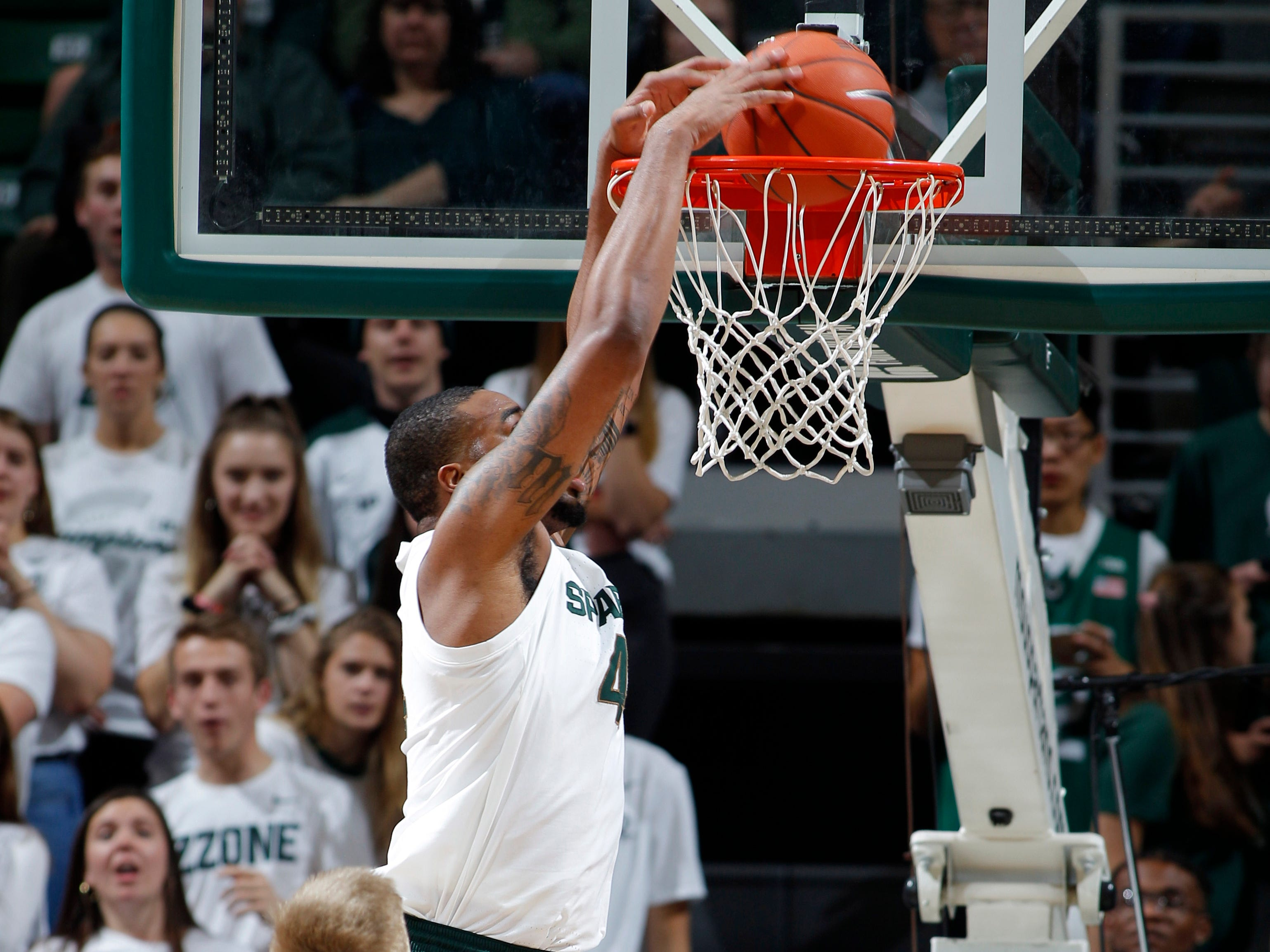 Michigan State's Nick Ward dunks against Northern Michigan, Tuesday, Oct. 30, 2018, in East Lansing, Mich.