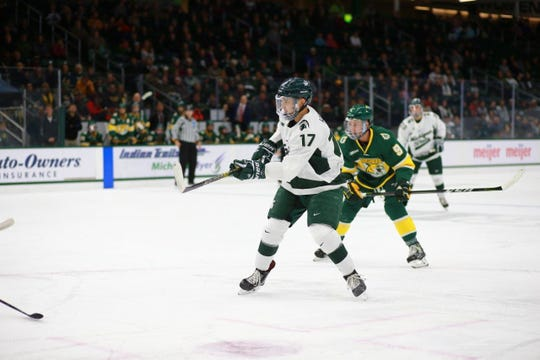 MSU forward Taro Hirose skates during the Spartans' game against Northern Michigan. Hirose was recognized as the NCAA and Big Ten First Star of the week after putting up six points in two games during last weekend's sweep over No. 8 Cornell.