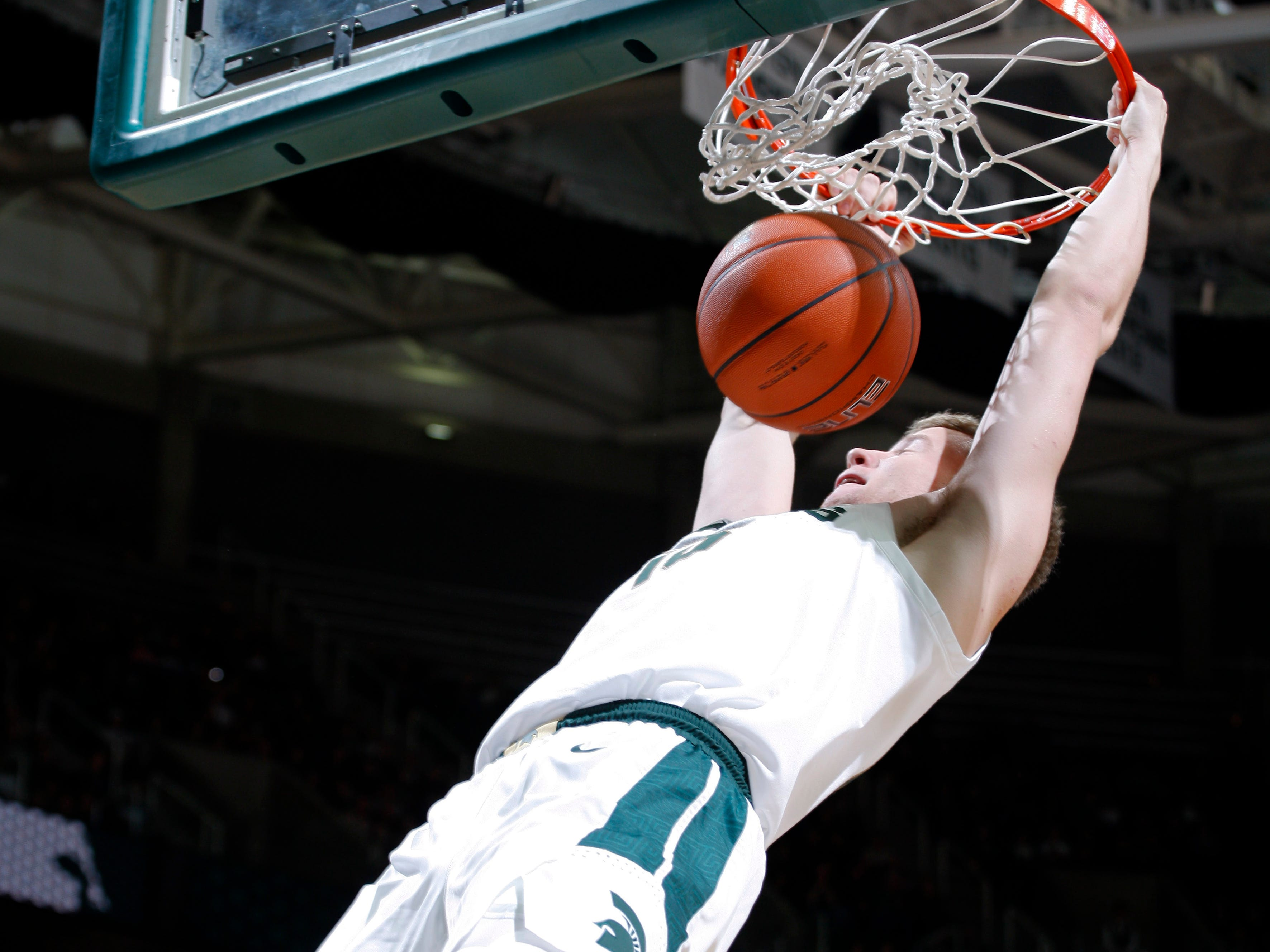 Michigan State's Thomas Kithier dunks against Northern Michigan, Tuesday, Oct. 30, 2018, in East Lansing, Mich.