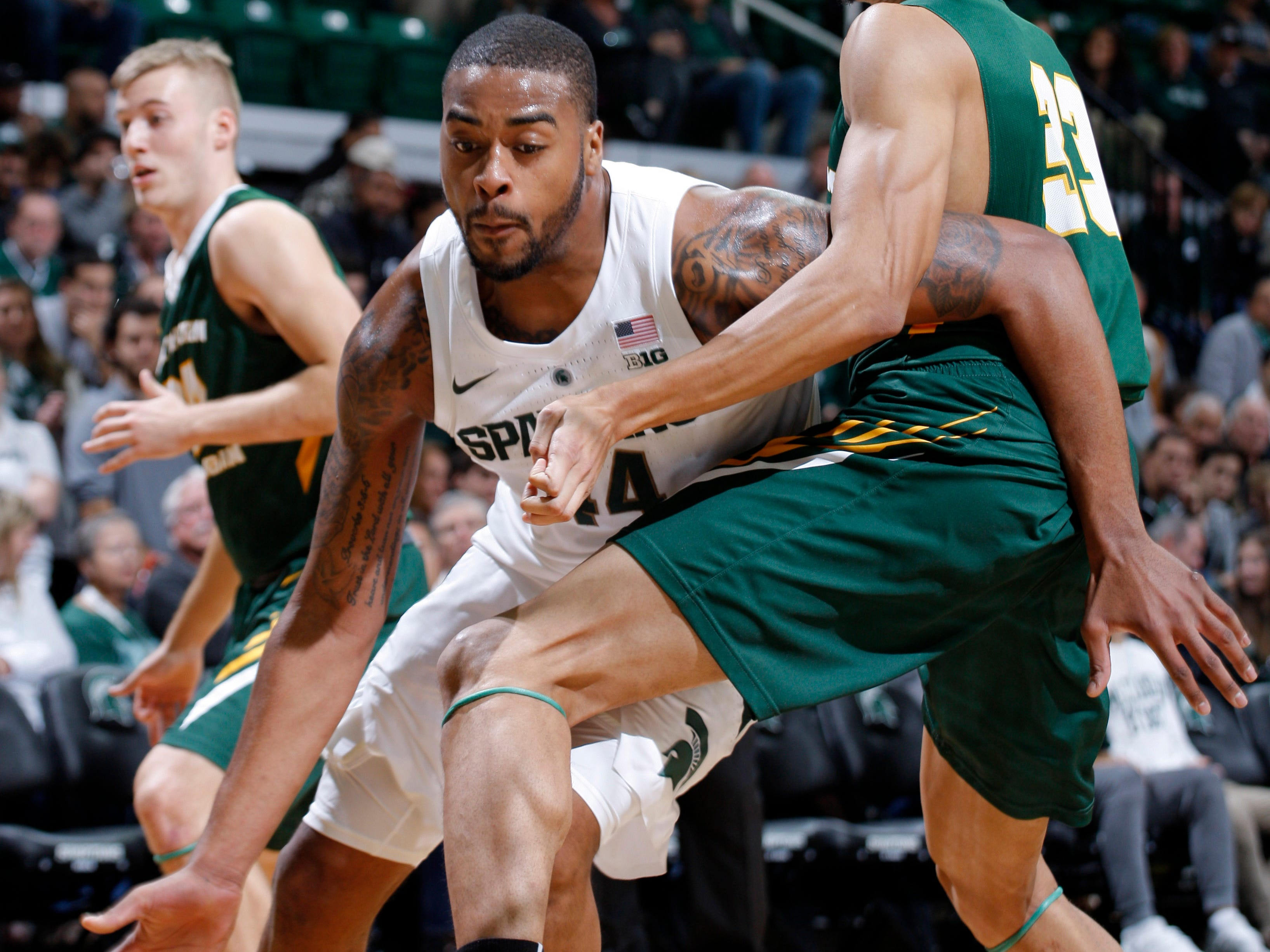 Michigan State's Nick Ward, left, drives against Northern Michigan's Myles Howard, Tuesday, Oct. 30, 2018, in East Lansing, Mich.