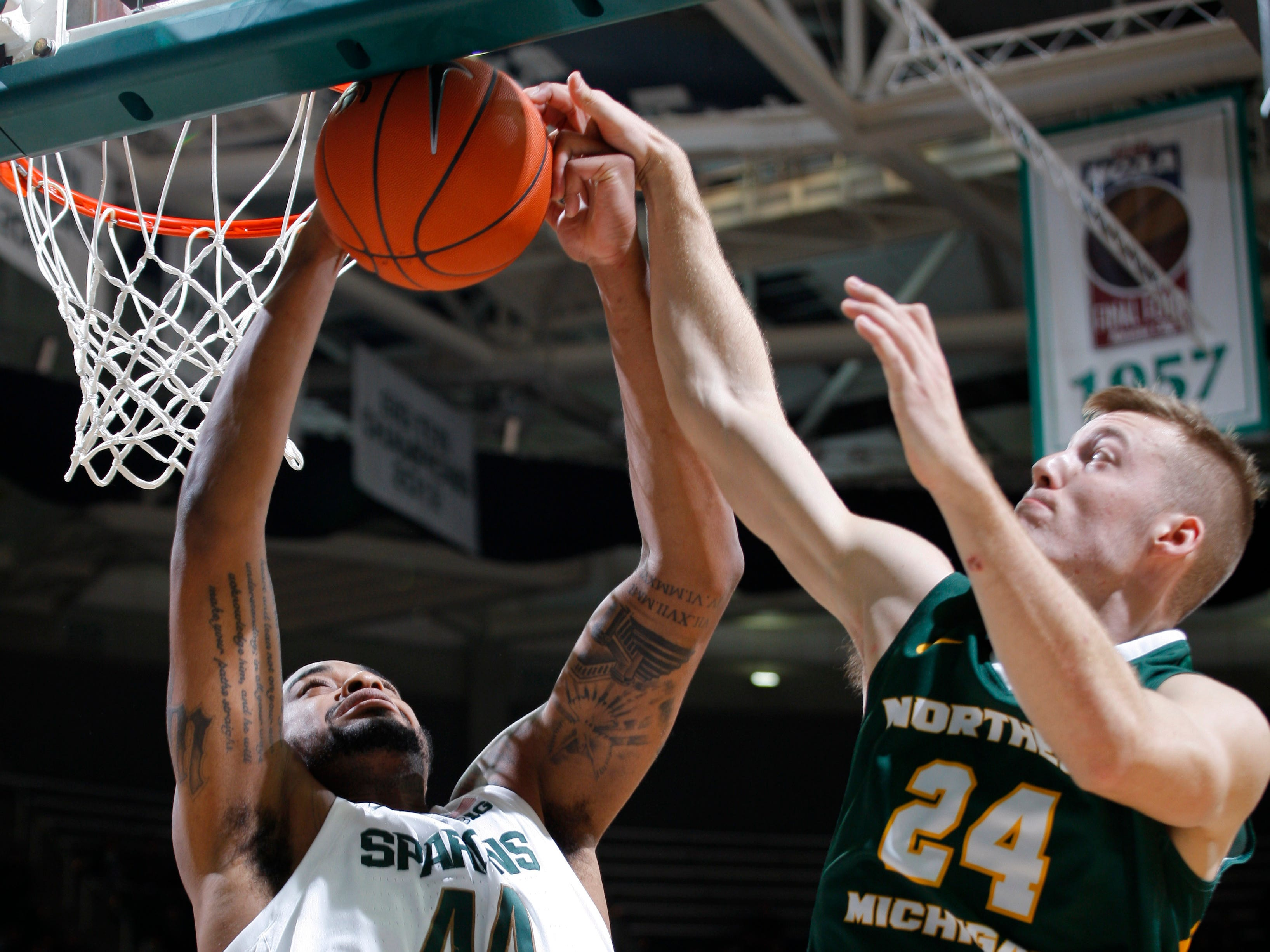 Michigan State's Nick Ward, left, and Northern Michigan's Alec Fruin battle for a rebound, Tuesday, Oct. 30, 2018, in East Lansing, Mich.