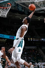 Michigan State's Marcus Bingham Jr. goes up for put-back dunk against Northern Michigan, Tuesday, Oct. 30, 2018, in East Lansing, Mich.
