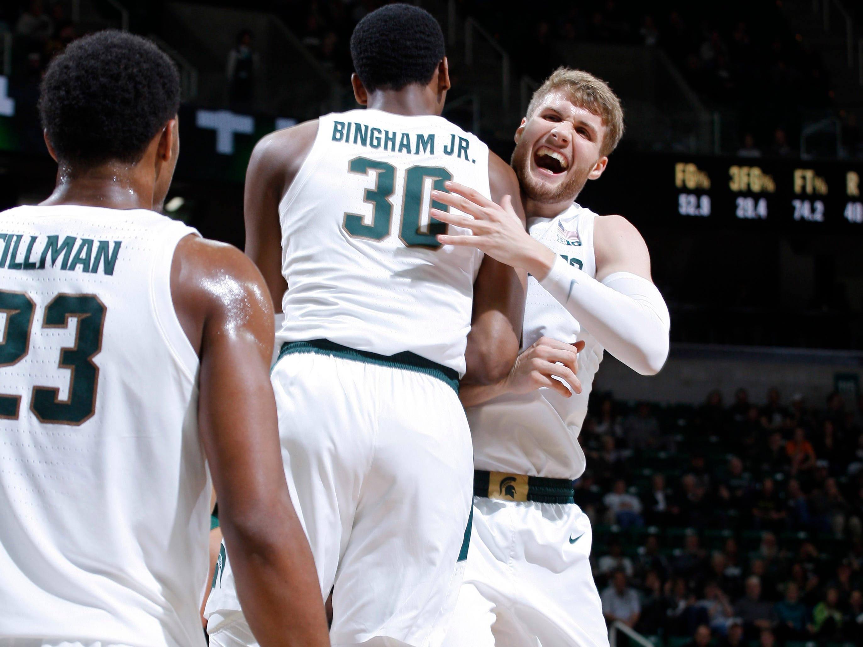 Michigan State's Marcus Bingham Jr. (30) and Kyle Ahrens, right, celebrate against Northern Michigan, Tuesday, Oct. 30, 2018, in East Lansing, Mich.