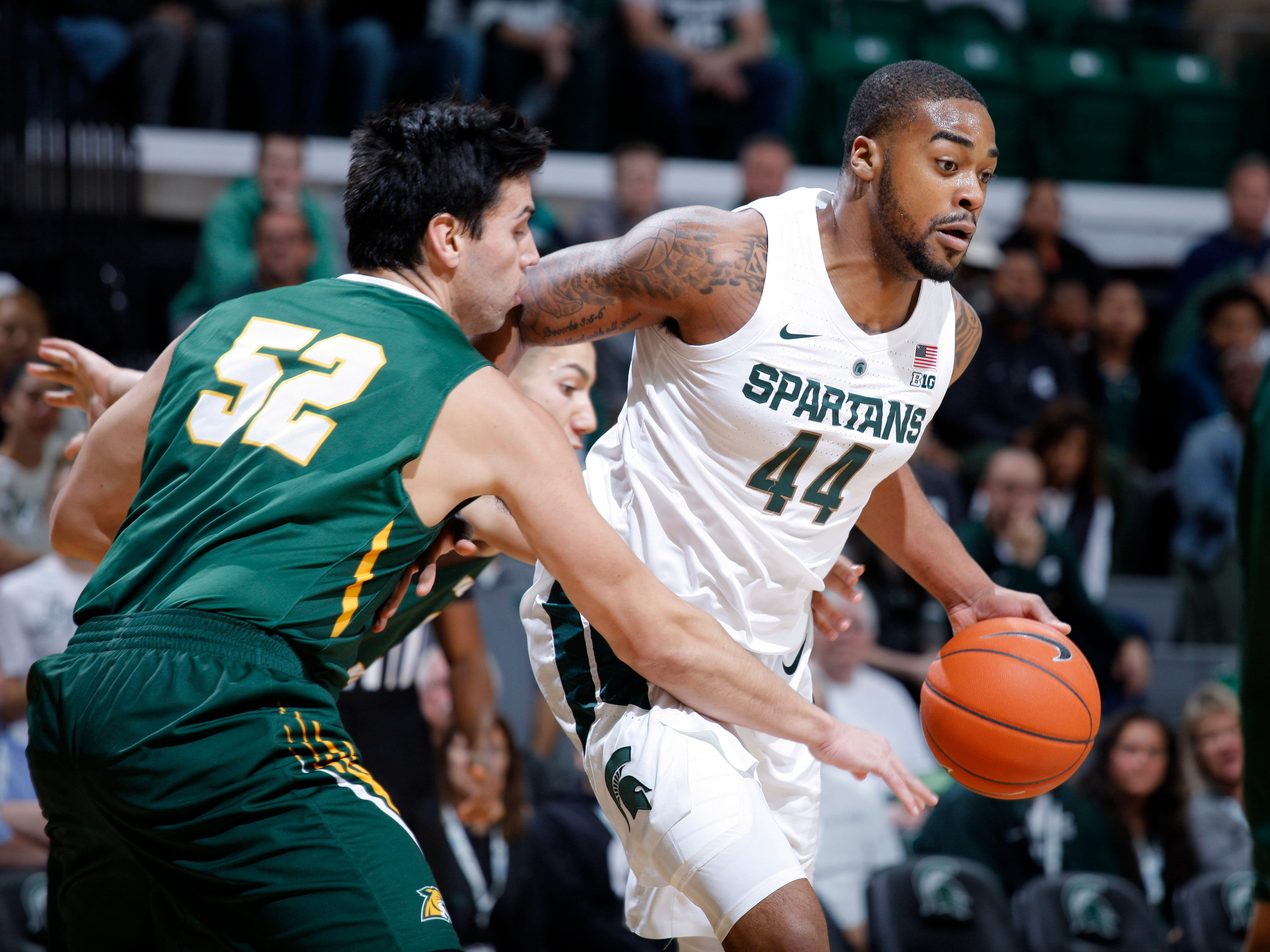 Michigan State's Nick Ward, right, maneuvers against Northern Michigan's Max Prendergast, Tuesday, Oct. 30, 2018, in East Lansing, Mich.
