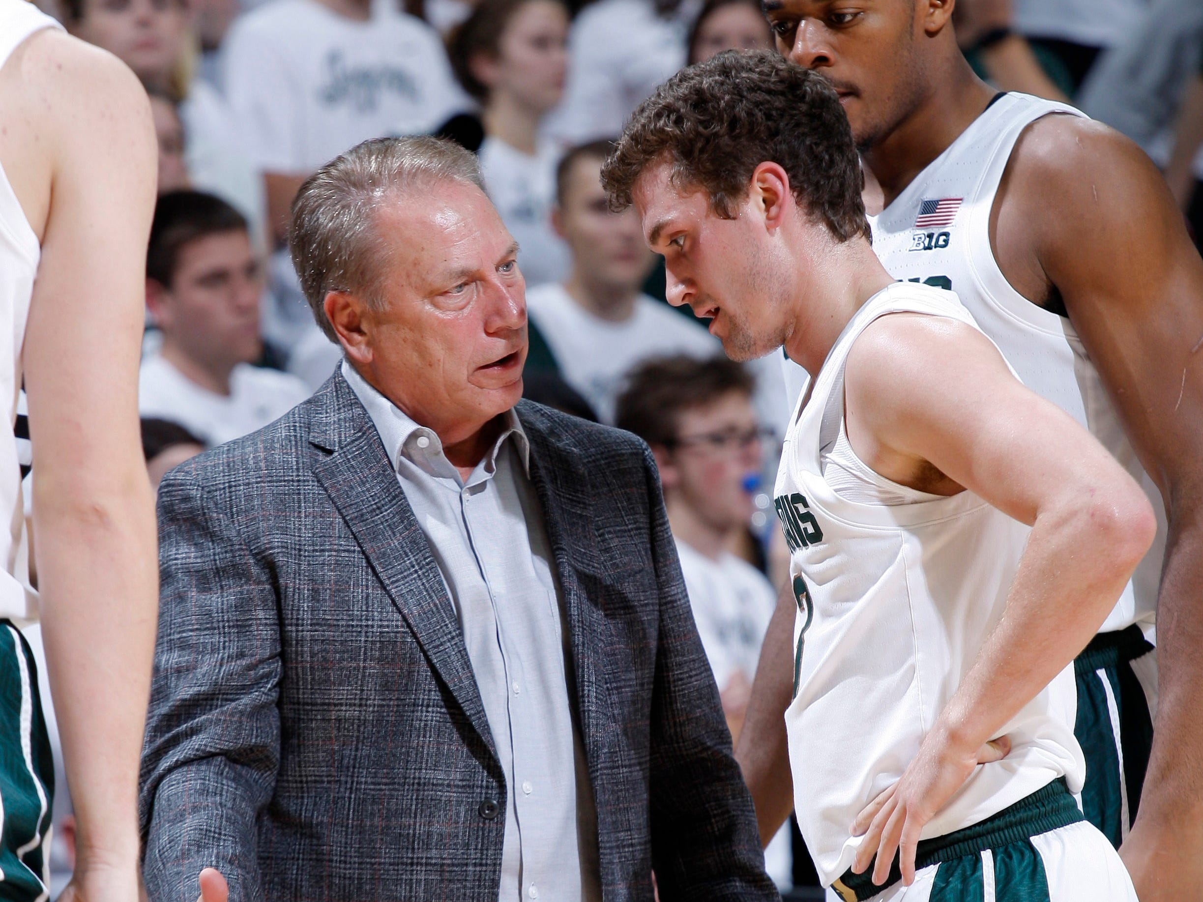 Michigan State coach Tom Izzo, left, talks with Foster Loyer Tuesday, Oct. 30, 2018, in East Lansing, Mich.