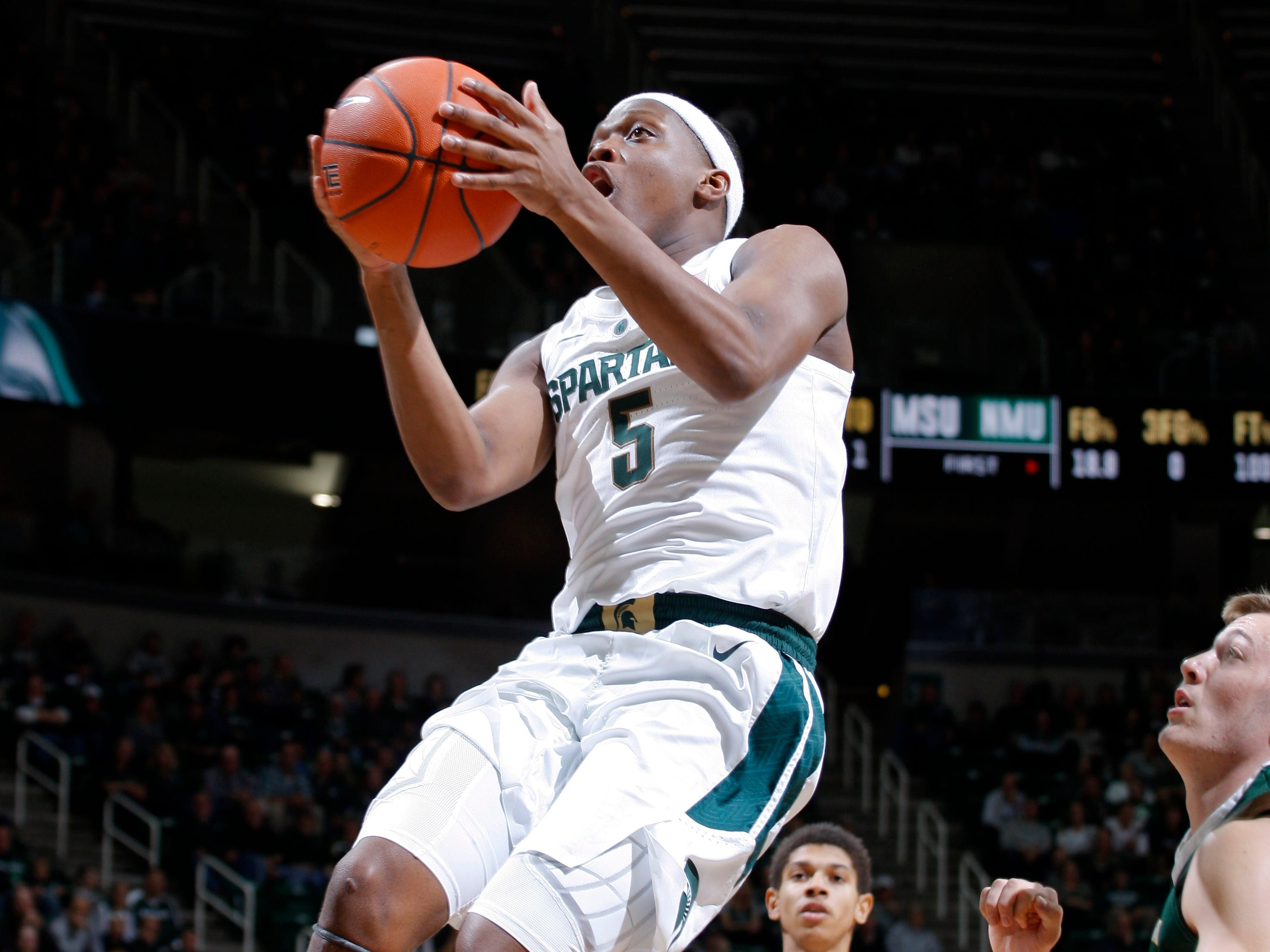 Michigan State's Cassius Winston (5) goes up for a layup against Northern Michigan, Tuesday, Oct. 30, 2018, in East Lansing, Mich.