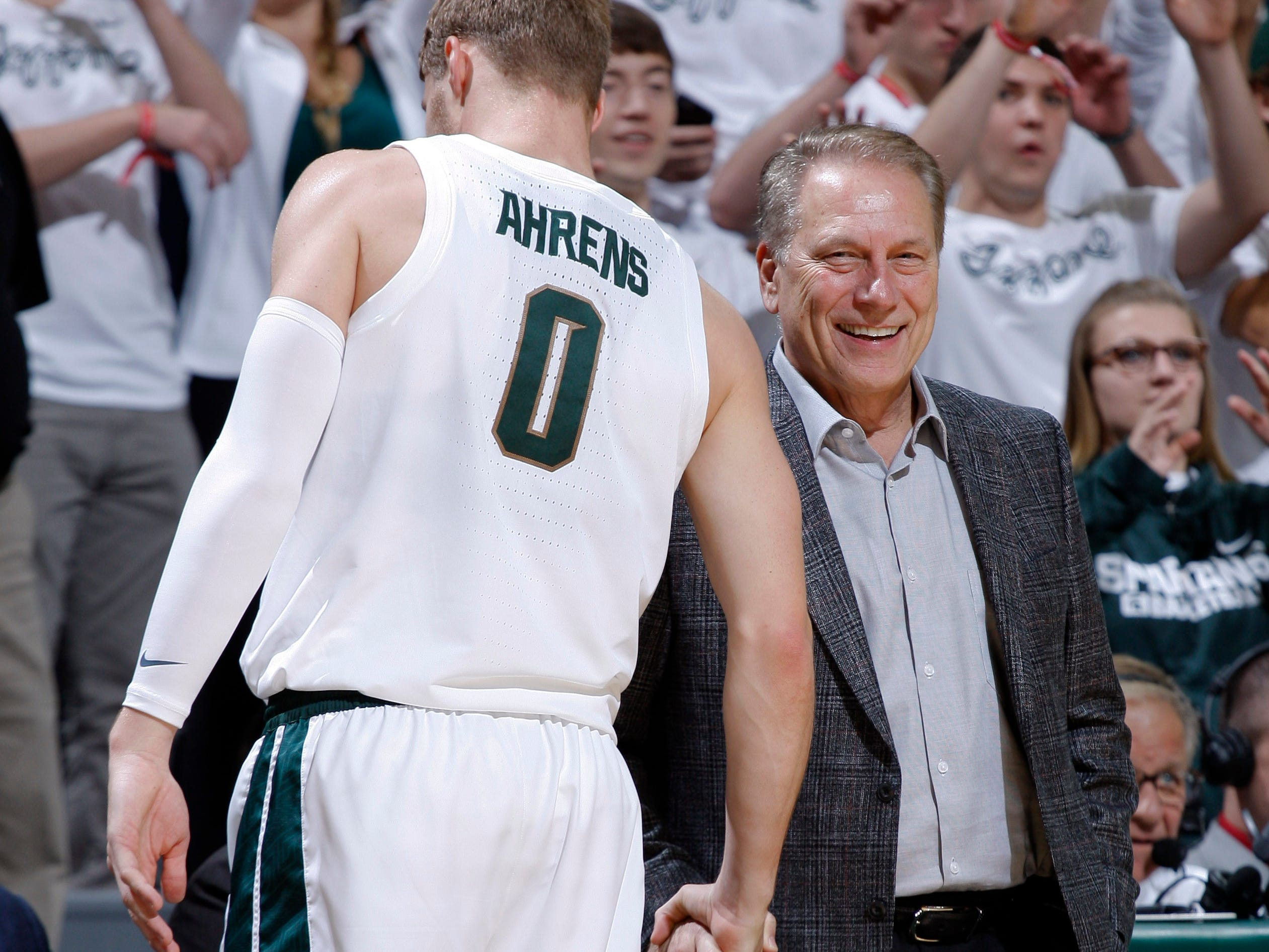 Michigan State coach Tom Izzo, right, talks with Kyle Ahrens (0), Tuesday, Oct. 30, 2018, in East Lansing, Mich.