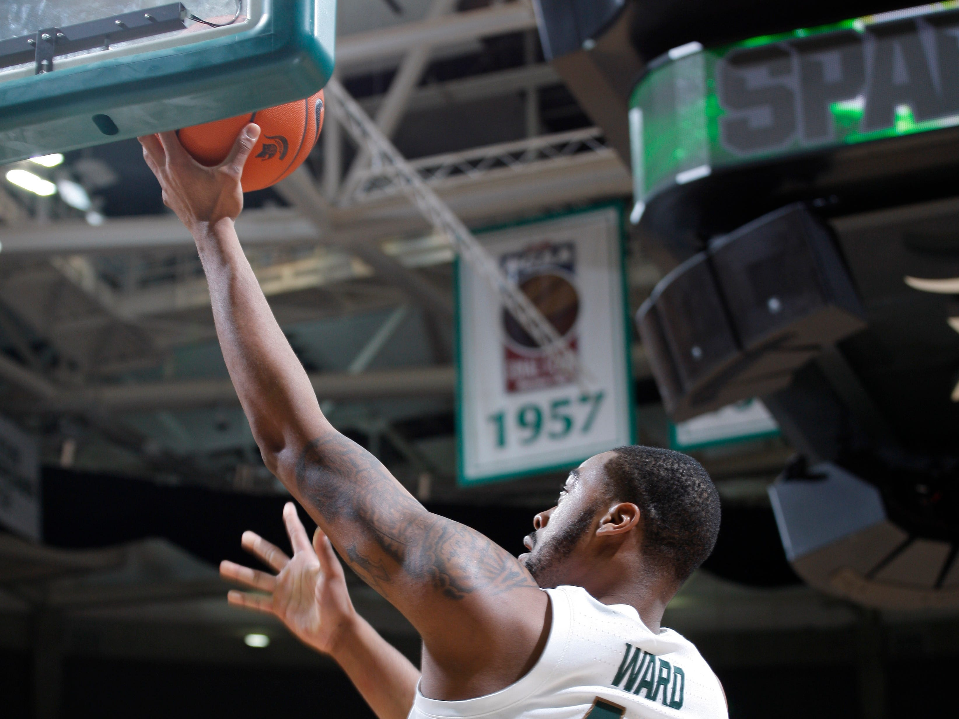 Michigan State's Nick Ward gets a layup against Northern Michigan, Tuesday, Oct. 30, 2018, in East Lansing, Mich.