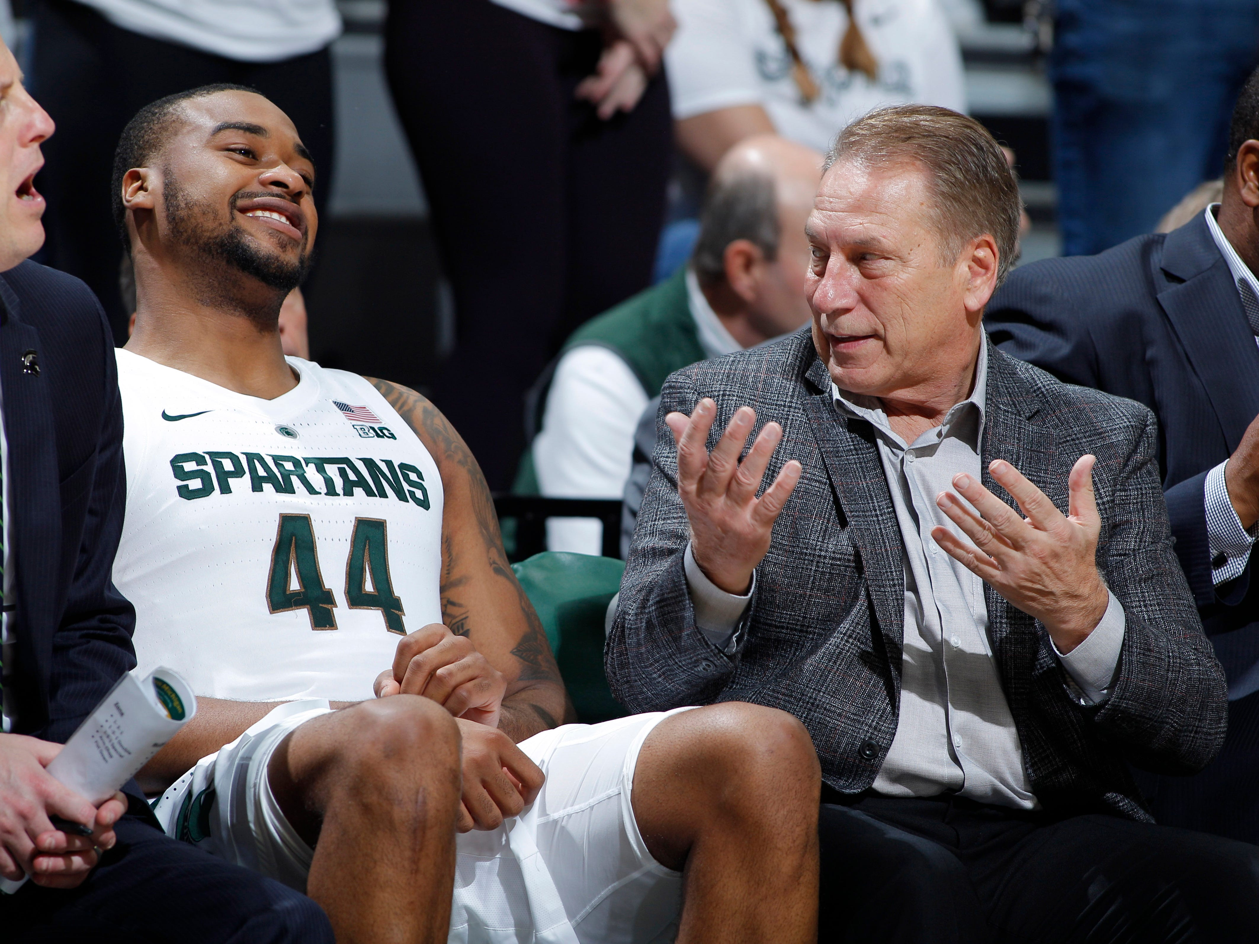 Michigan State's Nick Ward, left, and coach Tom Izzo, talk on the bench against Northern Michigan, Tuesday, Oct. 30, 2018, in East Lansing, Mich.