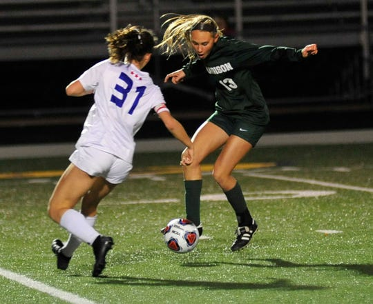 Madison's Talyor Huff kicks the ball while playing in Sandusky against Bay Village on Tuesday night.
