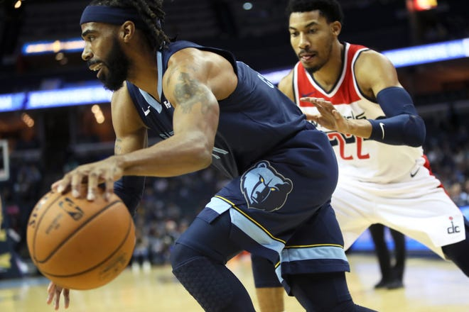Memphis Grizzlies guard Mike Conley drives past Washington Wizards guard Otto Porter Jr. during their game at the FedExForum on Tuesday, Oct 30, 2018.