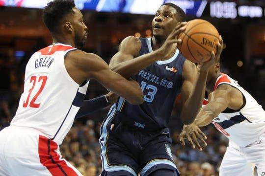 Grizzlies forward Jaren Jackson Jr. battles against the Wizards' Jeff Green, left, and Ian Mahinmi on Tuesday.