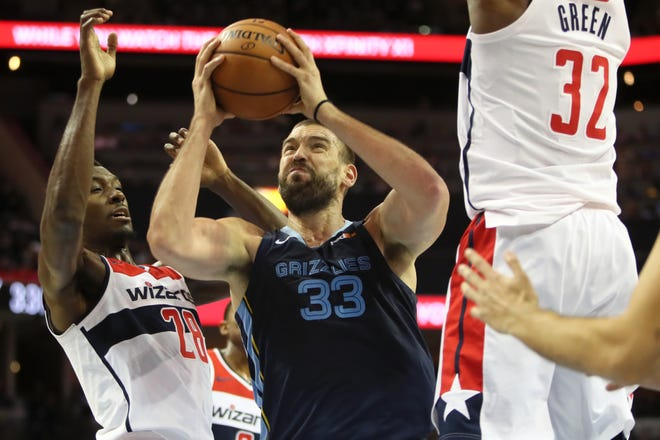 Grizzlies center Marc Gasol fights to get a shot up against the Wizards' Ian Mahinmi, left, and Jeff Green on Tuesday.