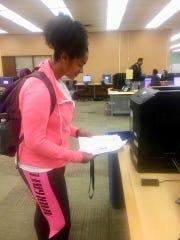 Selena McClure receives her absentee ballot.