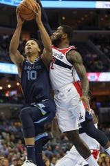 Memphis Grizzlies center Ivan Rabb makes a shot while getting fouled by Washington Wizards guard John Wall during their game at the FedExForum on Tuesday, Oct 30, 2018.