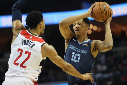 Memphis Grizzlies center Ivan Rabb looks to get the ball past Washington Wizards guard Otto Porter Jr. during their game at the FedExForum on Tuesday, Oct 30, 2018.