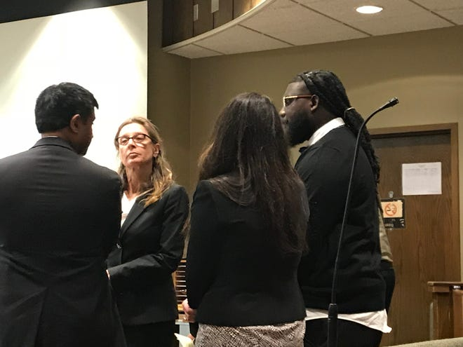 Defendant Tremaine Wilbourn consults with his defense team at the start of his first-degree murder trial on Wednesday. Wilbourn is charged with killing Memphis police officer Sean Bolton in 2015.