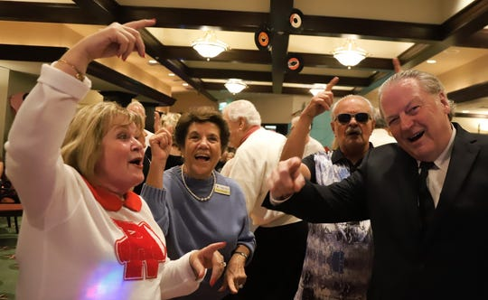 """MIYC member events chair Angela Holt, left, joins Grace and Dick Pantano on the dance floor along with Jon Holt, right, who played the role of Dick Clark for the """"American Bandstand"""" party."""