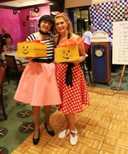 Yacht Club members Dale DeFeo, left, and Laurie Harris received awards for best costume.
