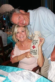 Sharon Cook and Dennis Smith (Hurricane survival kit winners).