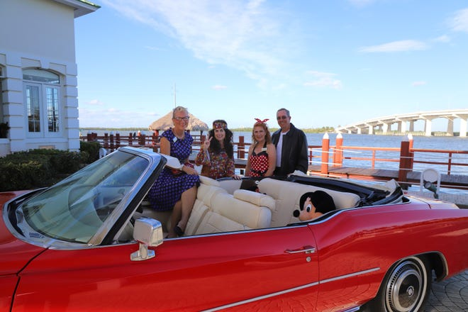 """A vintage red Cadillac convertible was parked at the entrance of the Yacht Club with """"50s kids"""" greeting members and guests as they arrived to join the fun. From left, Alice Jobe, Deb DeVries and Laurie and Randy Harris."""