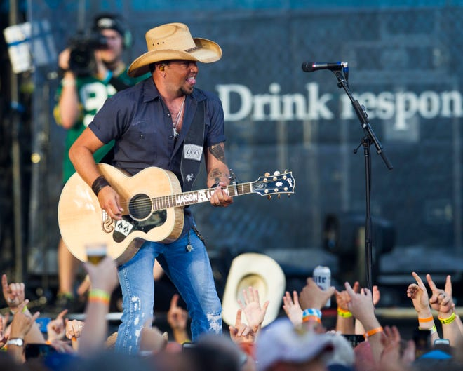 Jason Aldean performs at Lambeau Field as part of a stadium concert with Kenny Chesney on June 20, 2015. On June 28, 2019, he'll headline Summerfest's American Family Insurance Amphitheater.