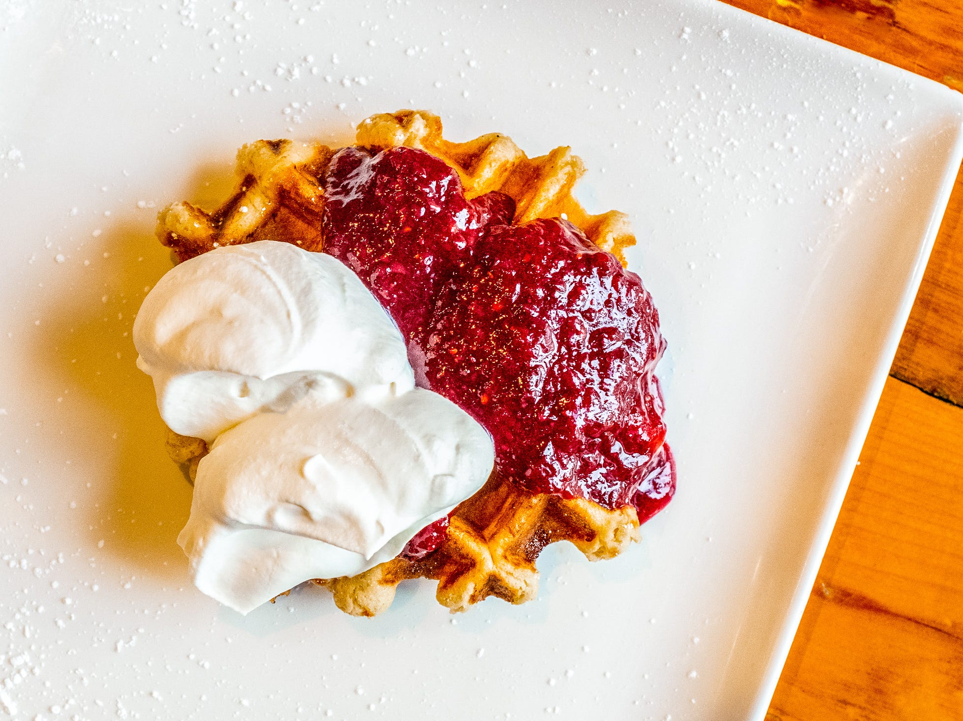 The Triple Berry Liège Waffle is made with house-made triple berry jam.