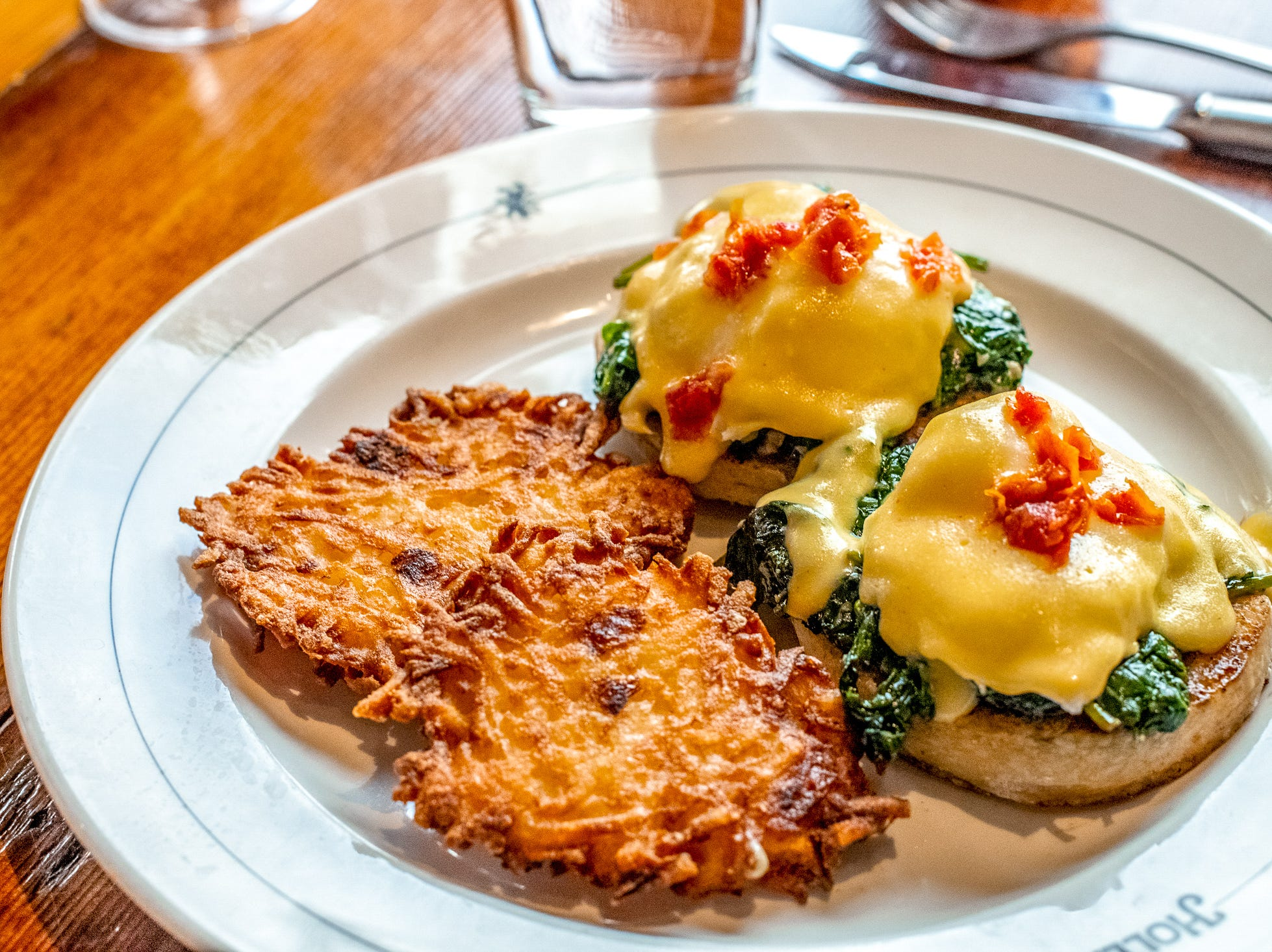 Café Hollander's new brunch menu includes a number of eggs benedicts such as the Florentine Benedict comes with garlic spinach, poached eggs, roasted tomatoes and house hollandaise.