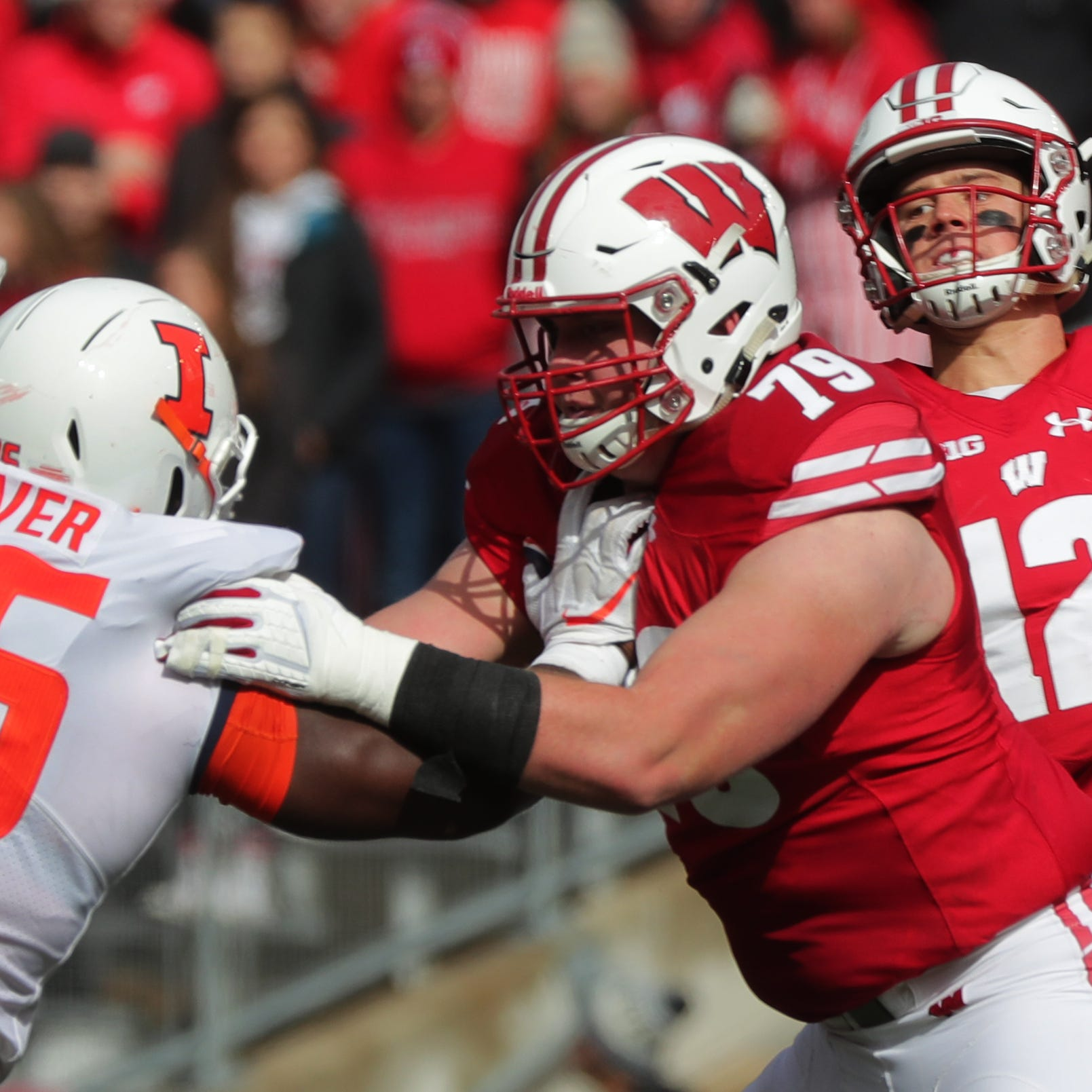 Wisconsin quarterback Alex Hornibrook (12) takes...