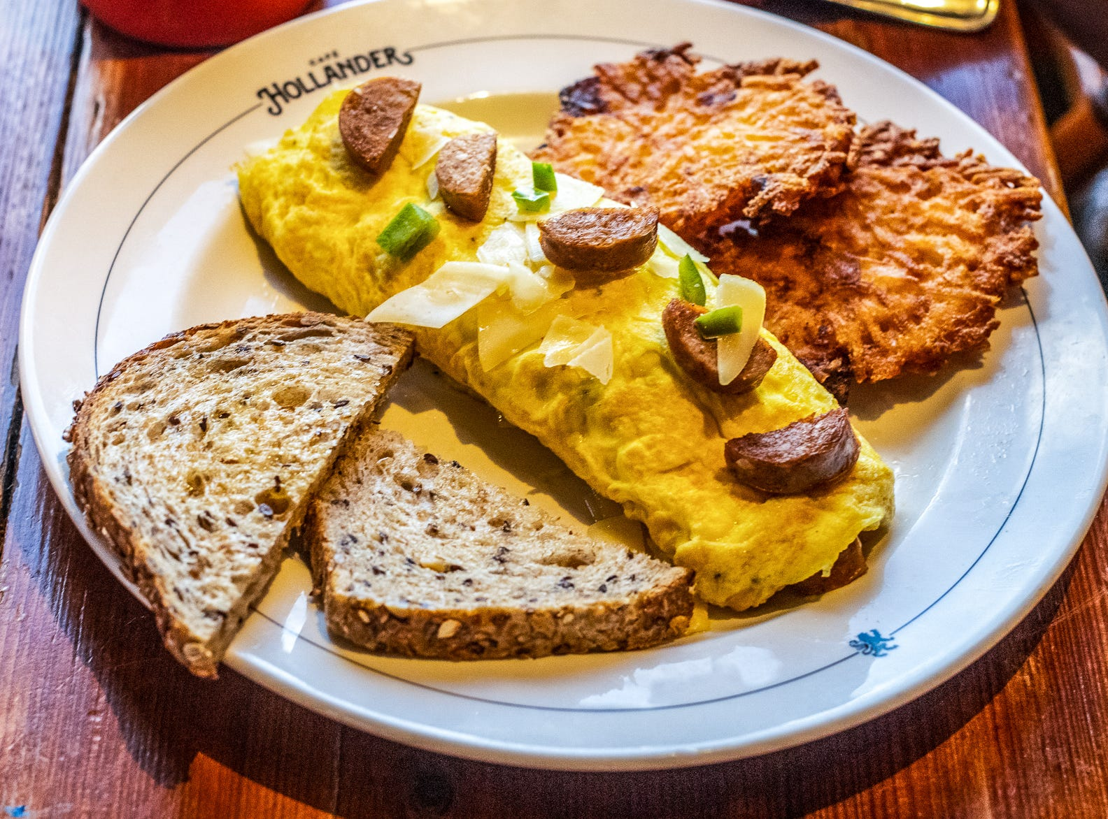 The Sausage & Three Cheese Omelette includes Hungarian sausage, jalapenos and asiago, romano and parmesan cheeses.