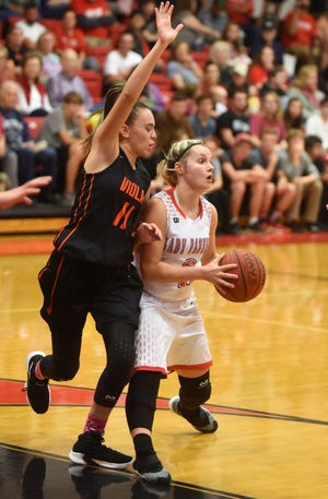 Norfork's Whitlee Layne is defended by Viola's Sami McCandlis during the Lady Panthers' 54-43 victory over the Lady Longhorns on Tuesday night.