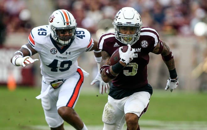 Texas A&M running back Trayveon Williams (5) is chased by Auburn linebacker Darrell Williams during a game at Kyle Field on Nov. 4, 2017, in College Station, TX
