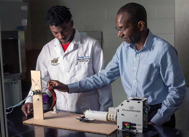 ASU's Dr. Derrick Dean at work in his lab .