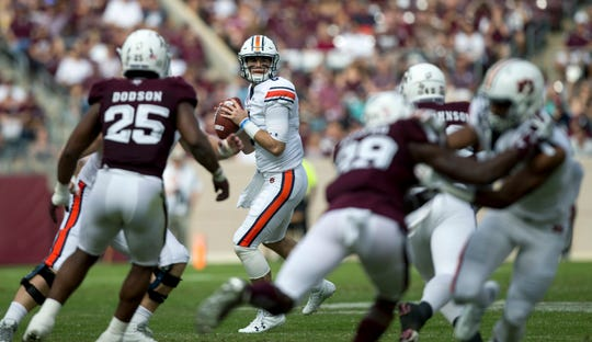 Auburn quarterback Jarrett Stidham (8) looks to pass against Texas A&M on Saturday, Nov. 4, 2017, in College Station, Texas.