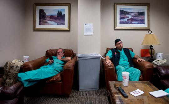 Dr. John Mark Vermillion, right, waits for his next surgery in a doctors lounge at Baptist Medical Center South in Montgomery, Ala., on Wednesday October 24, 2018.