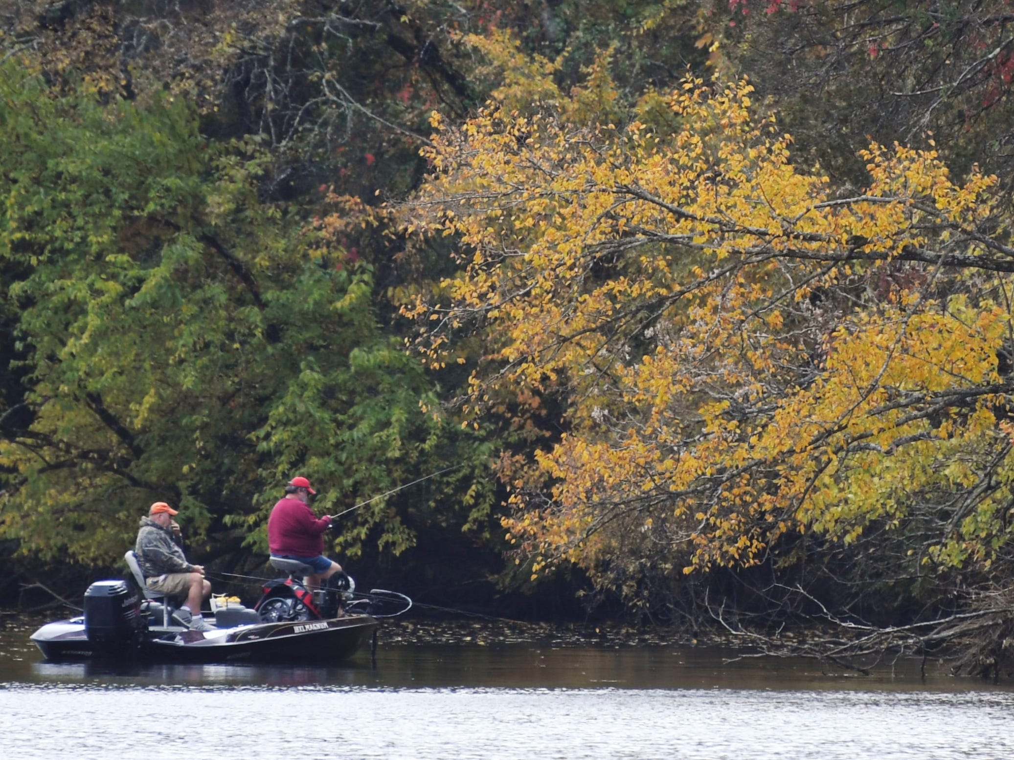 People fish on the lake in Gallatin as leaves start turning yellow on Wednesday, Oct 31, 2018.