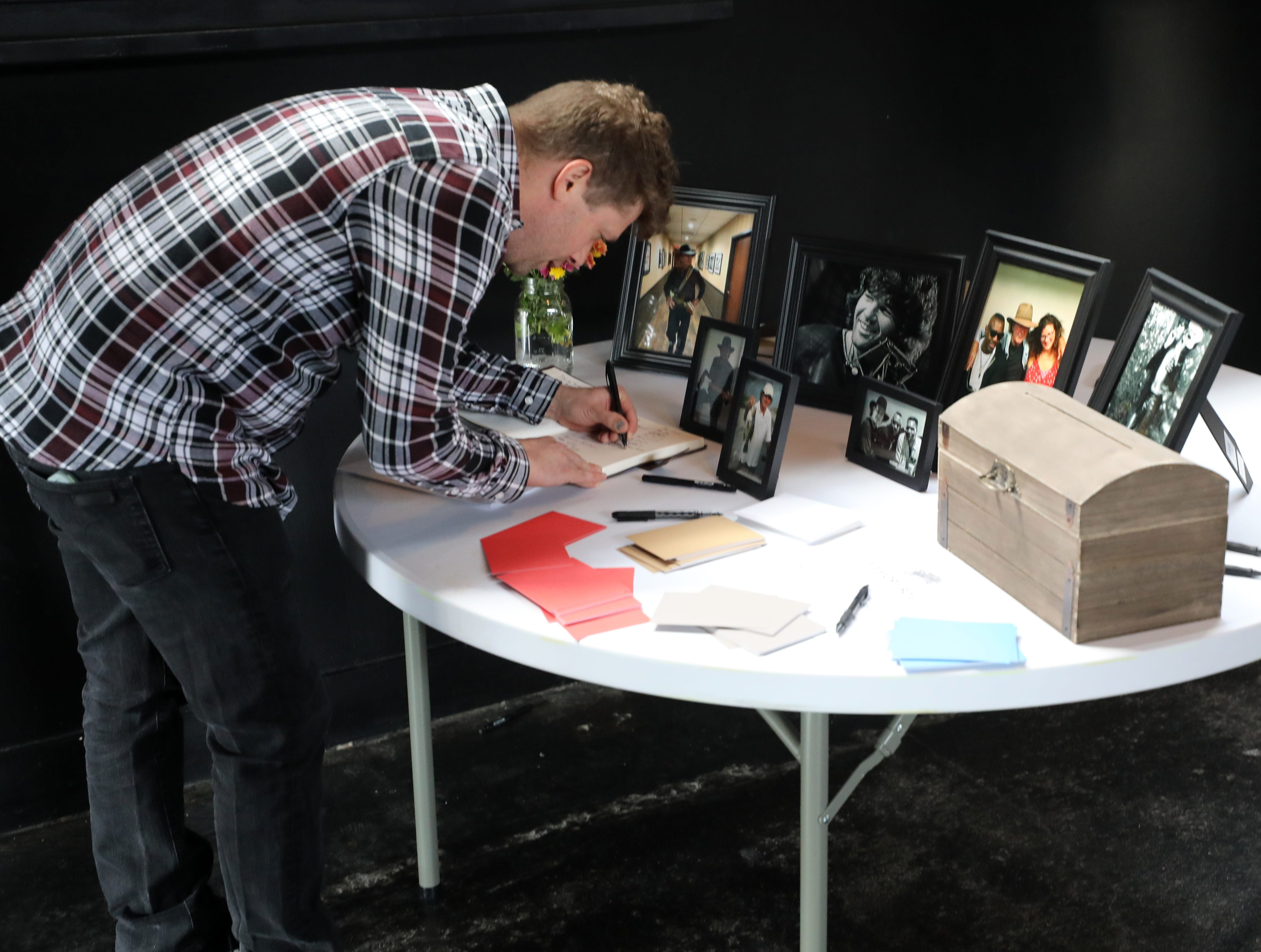 Rush Davenport signs the guest book at a Celebration of Life service held for singer-songwriter Tony Joe White at Marathon Music Works Wednesday, October 31, 2018.