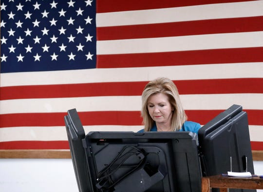 U.S. Rep. Marsha Blackburn, the Republican nominee for U.S. Senate in Tennessee, casts her ballot during early voting Wednesday, Oct. 31, 2018, in Franklin, Tenn.
