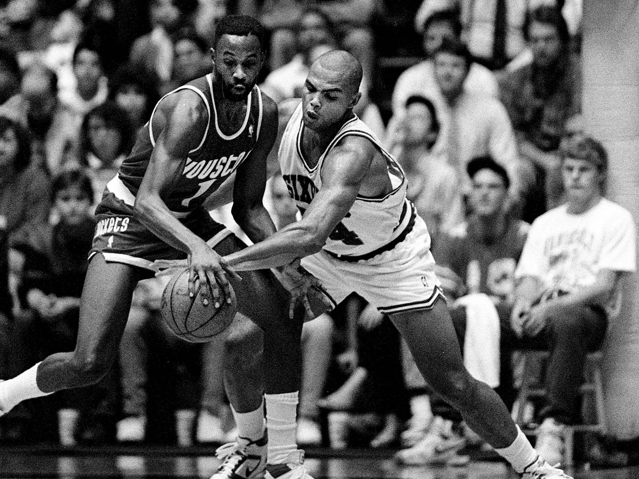 Philadelphia 76ers standout Charles Barkley, right, pesters Houston Rockets' Buck Johnson during their exhibition game before 5,347 NBA fans at Vanderbilt's Memorial Gym Oct. 27, 1988. Philadelphia staged a fourth quarter rally for a 123-118 win and Barkley had game high total of 24 points.