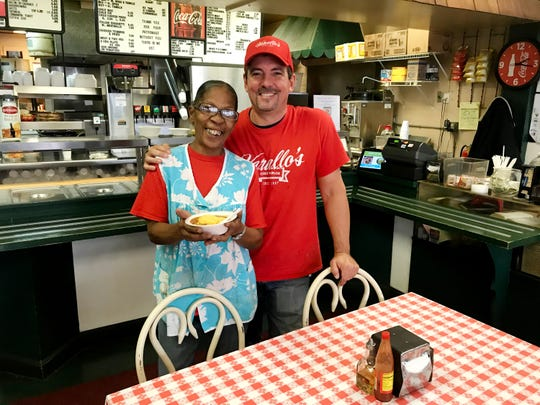 Todd Varallo and Cheryl McKnight show off the five-generation chili at Varallo's Restaurant.