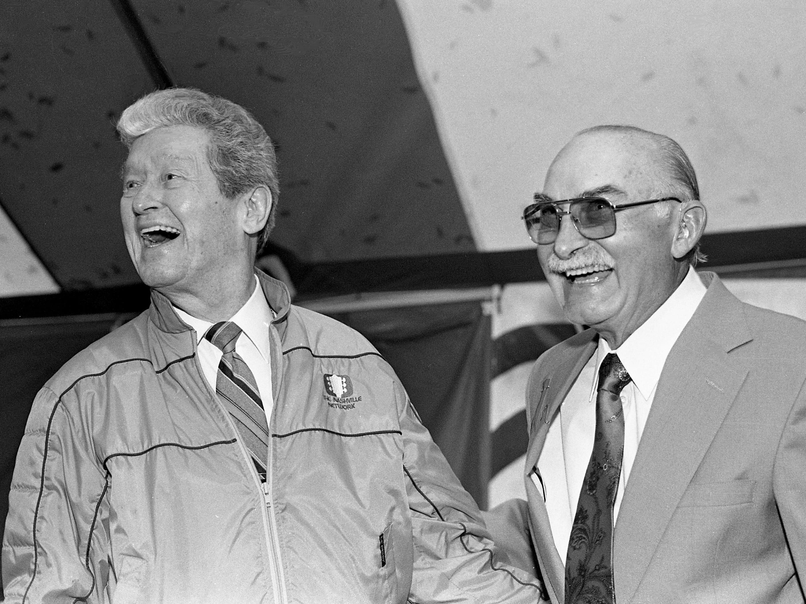 "Roy Acuff, left, and Grandpa Jones laugh during the tribute marking Jones' 60 years in country music at a Hendersonville farm Oct. 23, 1988. Acuff was one of the roasters who regaled the crowd with ""Grandpa stories."""