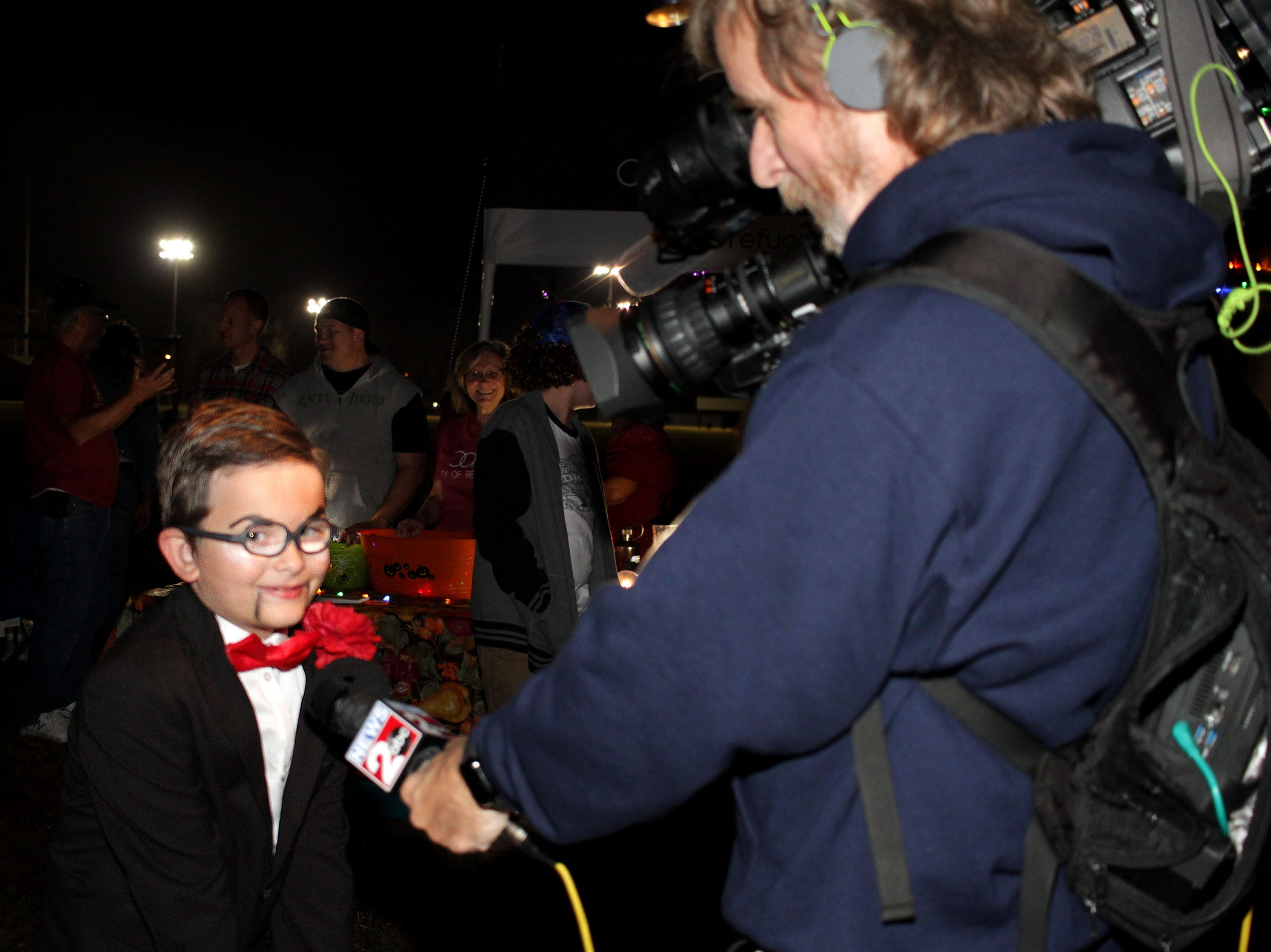 Nate Patterson (8) aka Slappy from Goosebumps II is interviewed while trick or treating at Drakes Creek Park in Hendersonville on Tuesday, October 30, 2018.