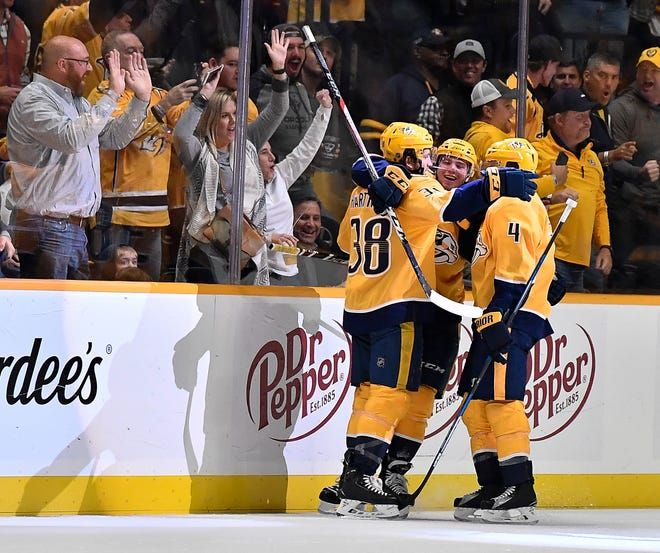 Predators teammates congratulate right wing Ryan Hartman (38) after his first goal during the second period against the Golden Knights at Bridgestone Arena Tuesday, Oct. 30, 2018, in Nashville, Tenn.