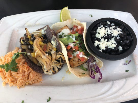 The tacos, shown here with mahi mahi and chicken, can come with corn or flour tortillas as well as an option to wrap them in lettuce.