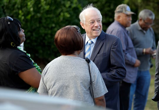 Former Tennessee Gov. Phil Bredesen, center, talks with voters as he campaigns Tuesday, Oct. 30, 2018, in Nashville, Tenn., in his bid for U.S. Senate.