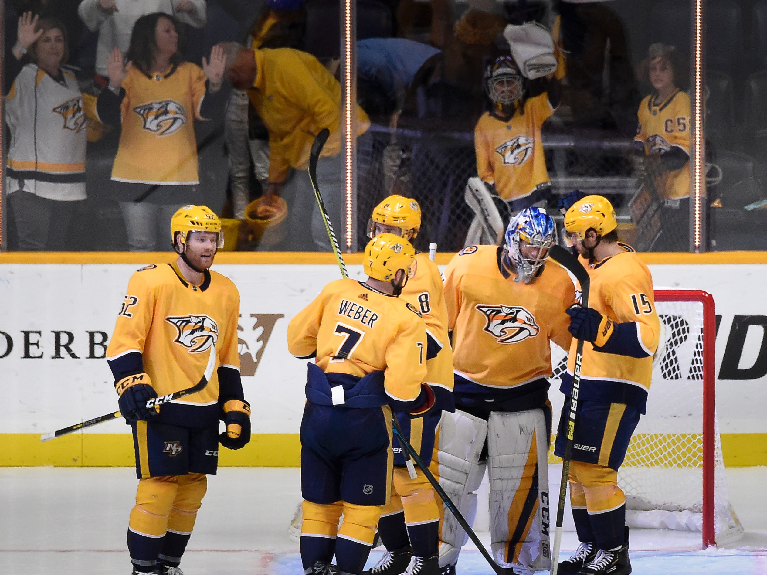 Predators teammates congratulate goaltender Juuse Saros (74) after their 4 to 1 victory over the Golden Knights at Bridgestone Arena Tuesday, Oct. 30, 2018, in Nashville, Tenn.